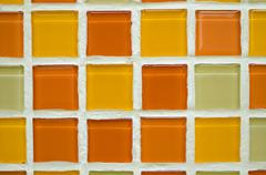 Color ceramic paltes samples on wall in build shop Stock Photos