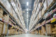 Stock Photo of rows of shelves with boxes in modern warehouse