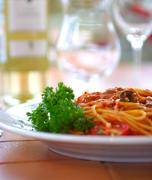 Stock Photo of spaghetti with a tomato sauce on a table in cafe