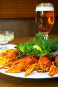 crayfishs with beer on a table at restaurant - stock photo