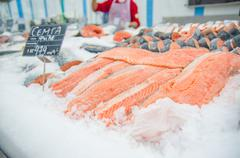 Fresh atlantic salmon lie on table with ice in supermarket Stock Photos