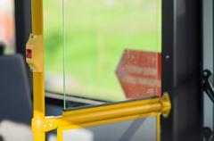 Interior of modern bus. stop alert button on handle Stock Photos
