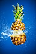 pineapple splashed with water - stock photo
