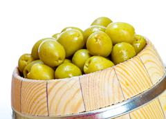 olive in small barrel - stock photo
