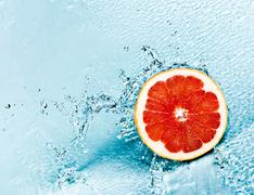 Stock Photo of grapefruit and water