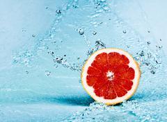 Grapefruit and water Stock Photos