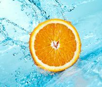 Orange and water Stock Photos