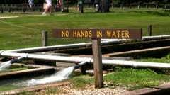No hands in water sign at fish hatchery Stock Footage