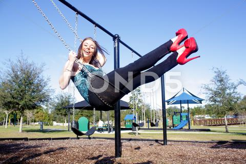 Stock photo of lovely, voluptuous brunette on a swing (7)