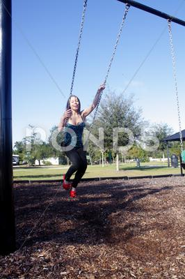 Stock photo of lovely, voluptuous brunette on a swing (9)