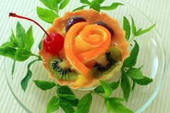 Pastry with orange, cherry and kiwi Stock Photos