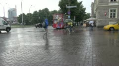 Estonia Tallinn in rain wtih pedestrians and a bicyle s Stock Footage