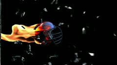 Football-Helmet on fire breaking glass with Alpha Stock Footage