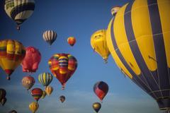 Stock Photo of tourists ride hot air ballons during a mass ascension