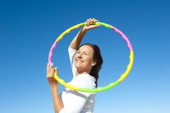 Active senior woman hula hoop exercise Kuvituskuvat