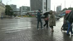 Estonia Tallinn people by a street in the rain s2 Stock Footage
