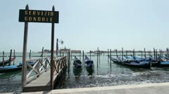 Parked Gondolas at ride port in Venice Stock Footage