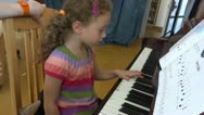 Reading music notes piano lesson Stock Footage
