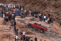 Ford truck climbing steep rock mountain Moab Utah 0156 Stock Photos