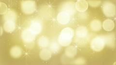 Gold bokeh lights particles and starglow loop Stock Footage