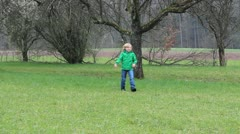 Child throwing boomerang Stock Footage