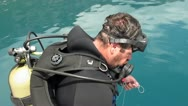 Stock Video Footage of Scuba-diver getting ready and jumping in to the sea