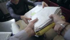 Person takes a stack of documents - stock footage