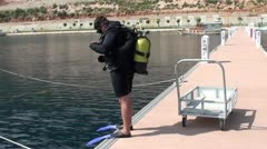 Scuba-diver getting ready and jumping in to the sea 2 Stock Footage