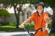 African american boy child riding bike Stock Photos