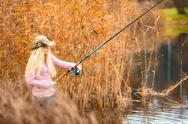 Woman fishing Stock Photos