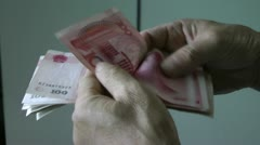 Countin Chinese money Stock Footage