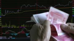 Man are counting money, the stock market background Stock Footage