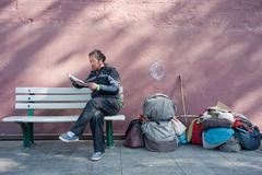 Beijing,china-april 16,, 2012: unknown to beg for old man sitting in a royal Stock Photos