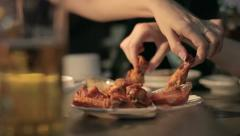 People eat grilled chicken at the bar 2 Stock Footage
