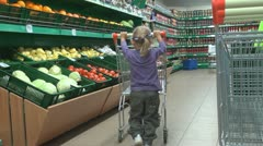 Child with a Shopping Cart at Supermarket, Little Girl at Store, Children Stock Footage