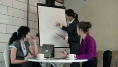 Business meeting, businesswoman drawing downward graph on board HD Stock Footage