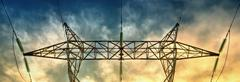Dramatic sky and electricity pylon Stock Photos