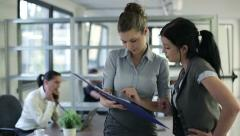 Attractive young businesswomen with documents in the office HD Stock Footage