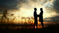 loving couple at sunset - stock footage