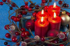 Advent candles berry wreath Stock Photos