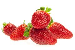 Juicy strawberries isolated on white Stock Photos