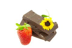 Chocolate, strawberry and flower isolated on white Stock Photos