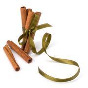 Festive wrapped cinnamon sticks Stock Photos