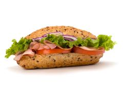 Fast food baguette sandwich with lettuce, tomato, ham and cheese Stock Photos