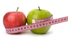 apple with tape measure. healthy lifestyle concept. - stock photo