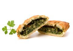 puff pastry. healthy pasty with spinach. - stock photo