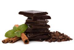 Stock Photo of chocolate bars stack and cinnamon sticks