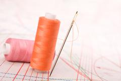 spool of thread and needle. sew accessories. - stock photo