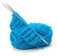 Stock Photo of woollen thread and knitting needle. needlework accessories.