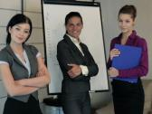 Three successful happy businesswomen in the office NTSC Stock Footage